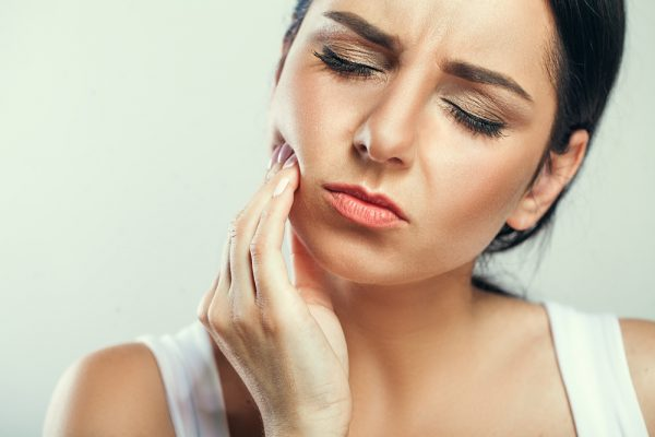 Woman with Toothpain